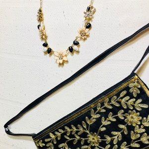 Kate Spade Floral gold toned necklace Express purs